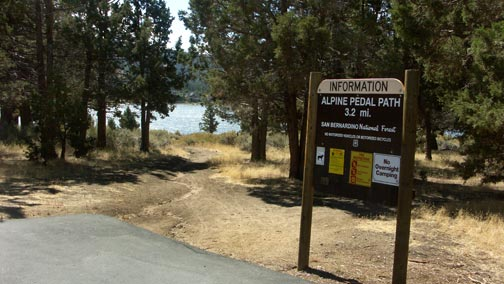 The junction of the Big Bear Alpine Pedal Path and the Cougar Crest trail.  Highway 18 is in the background at the upper right.