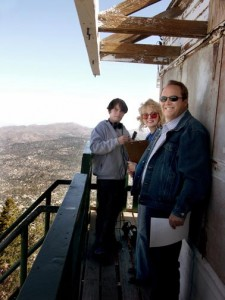 From left to right cameraman Josh Patterson, hosts Kim & Tim Sweet get ready to film an history Show episode for Channel-6 Big Bear from the deck of the Butler Peak fire lookout tower. © Rick Keppler