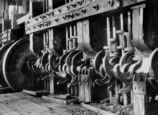 An interior photo of the Baldwin stamp mill showing of the mills eight stamp batteries.  When operating the noise from these stamps could be heard throughout Big Bear Valley. - Rick Keppler collection..